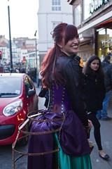 7D0065a Red haired girl in black blows & wearing her bussl outid a purple & green dress - Whitby Goth Weekend 3rd Nov 2012 (gemini2546) Tags: nov red green leather goth week haired 3rd long black red 2470 tafita frame canon sigma hair 7d lens lady basque skirt purple blouse whitby 2012 victorian busstle