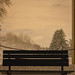 bench snow and a 50:s backdrop