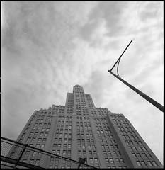 Fountainhead (TheRobbStory) Tags: nyc sky blackandwhite ny newyork building 120 6x6 film architecture brooklyn analog zeiss mediumformat delta scan f45 hasselblad pro epson gothamist 100 v600 ilford swc 38mm biogon robbhohmann