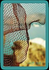 through ... (~evi's...~) Tags: light sea abstract beach nature colors frames rocks bokeh greece hdr fishingnets perama magagr picmonkey