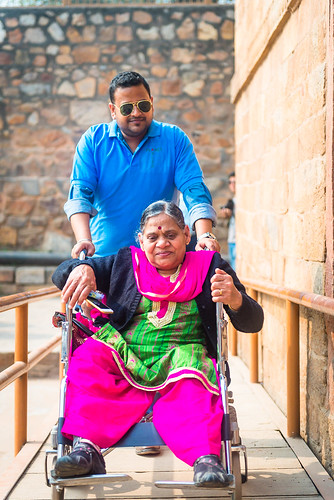 Accessible Tour of Qutub Minar: Our travel buddy accompanying one of the traveller during the tour.