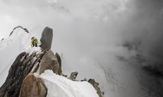Climber at Mont Blanc (Justin Sharer) Tags: nature leefilters ndgrad 5dmarkiii 1635mm wideangle europe summer fog clouds snow climber chamonix france montblanc