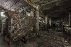 Dark chocolate (Kriegaffe 9) Tags: rust damp chocolate machines pillars decay cage wheel