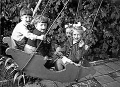 Birthday Boy on a Boat Swing (TietjenUK) Tags: tietjenuk 1953 bw blackandwhite blackwhite kids children monochrome playtime fun swinging swingers boat 51tonfieldroad sutton michaelwoodhams bobbymorgan jillbye cousin 53tonfieldroad surrey