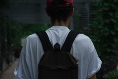 (Taran W) Tags: people portraiture portrait youth back shoulders backpack head hair hat plants garden center