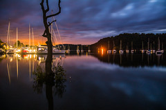 Windermere (iratebadger) Tags: nikon nikond7100 d7100 nikkor scenic scenery sky clouds lake lakedistrict water boat boats cumbria longexposure tripod night nikonphotography nightshot countryside country nationalpark reflections reflection tree silhouette lightroom lights orange