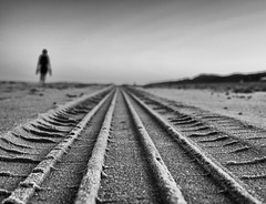 Off the track II (Dan-Schneider) Tags: blackandwhite bw beach lines olympus omdem10 monochrome mood schwarzweiss human streetphotography sand track