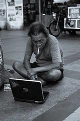 Killing time. (bemylemonlime) Tags: decisivemoment watchingpeople smoking streetphotography everywhereishoot