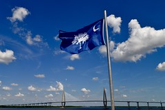 Arthur Ravenel Jr. Bridge and the South Carolina Flag -  Seen from the Deck of the USS Yorktown - Patriots Point - Mount Pleasant South Carolina (Meridith112) Tags: flag sky bluesky clouds cloud bridge charlestoncounty charleston mountpleasant sc southcarolina south lowcountry carolinas summer august 2016 nikon nikon2485 nikond610 arthurraveneljrbridge southcarolinaflag ussyorktown navy military patriotspoint cooperriver river 1775