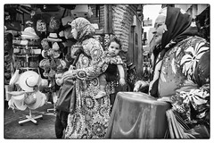 Got baby's attention @ Marrakech (PaulHoo) Tags: marrakech morocco africa street candid streetcandid streetphotography 2016 summer city urban citylife lightroom people women woman fashion family baby nik silverefex