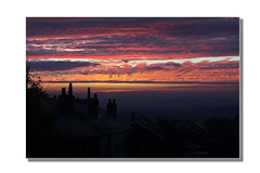 Another Sunrise (SFB579 Namaste) Tags: morning blue roof red chimney sky orange sun house building tree home silhouette clouds sunrise dark fire early am skies glare pentax top wide sigma wideangle panoramic wakefield rise k5 outwood