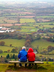 red and blue states - a vision (Kumukulanui) Tags: sunset england bench togetherness couple view searchthebest dusk together worcestershire herefordshire redandblue viewpoint redstate bluestate greatmalvern worcestershirebeacon westmalvern