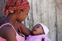 African mother (sidaction) Tags: poverty africa family pink red portrait people woman baby black love girl smile look childhood female dark mom outdoors person holding child looking adult affection african mommy small headscarf mother tshirt parent bond botswana motherhood thirdworld scarcity singleparent