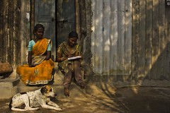 ... (Kals Pics) Tags: life light people woman dog india girl lady canon education daughter mother streetphotography streetlife wideangle learning chennai tamilnadu villagepeople cwc villagelife rurallife ruralindia ramapuram lightandlife indianvillages 550d incredibleindia nandambakkam ruralpeople singarachennai kalspics 18135mmis mgrnagar chennaiweelendclickers fabulouschennai