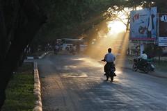 into the light (leaving-the-moon) Tags: sun traffic burma streetlife myanmar dust birma sunbeam onthestreet