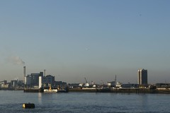 Across the river (will668) Tags: chimney london tower water ferry thames buildings river boats boat industrial factory crane smoke tide towers jet aeroplane cranes bouy takeoff riverthames thamesbarrier woolwichferry woolwicharsenal tateandlyle