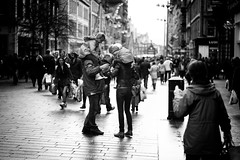 Giants (stephen cosh (on holiday)) Tags: life street city family people blackandwhite bw sepia kids fun piggy mono parents scotland town back glasgow candid streetphotography buchananstreet rangefinder ayr piggyback reallife humancondition blackandwhitephotos 50mmsummilux blackwhitephotos leicam9 stephencosh leicammonochrom leicamm cokeyback