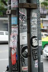 Bangkok Bass Music (jcbkk1956) Tags: bangkok thailand thonglo street streetfurniture stickers lampost fuji xt1 carlzeiss manualfocus 45mmf28 dof worldtrekker