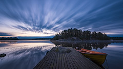 Sunday morning (jarnasen) Tags: d810 nikon nikkor 1635mmf4 tripod longexposure le extreme dawn morning early sunrise sky clouds movingclouds water jetty boat color nature leefilters landscape nordiclandscape nd10 bigstopper ndfilter island landskap lake lakescape vrdns stergtland sweden sverige copyright jrnsen jarnasen reflections rock revisit september light lightchasing storarngen 8min jusig blue orange sunlight naturfoto boats