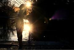 Swing life away (Ideophobia) Tags: light sun sunlight reflection girl self hair sunflare hairflip sunflares