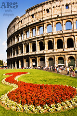 Colosseum (A S H O K) Tags: flowers red people italy rome flower building architecture modern canon roman wideangle colosseum empire 1855 gress differentview differentangle 1000d mostvisitedplace decoratedflowers ashokks