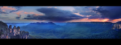 A Tourists View || KATOOMBA || BLUE MOUNTAINS (rhyspope) Tags: new pink blue sunset orange cliff 3 mountains yellow rock wales sisters photoshop sunrise landscape golden three high mt dynamic stitch pano south scenic australia bluemountains tourist panoramic mount valley nsw threesisters aussie solitary range jamison hdr katoomba 3sisters leura escarpment mtsolitary echopoint jamisonvalley rhyspope