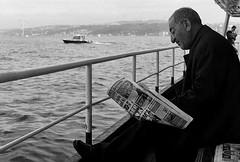Bosphorus commute (Stephen Dowling) Tags: travel winter sea blackandwhite film ferry 35mm turkey paper mono boat candid istanbul m42 bosphorus smctakumar5014 pentaxesii