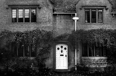 White Door and Down Pipe, Broadway, Worcestershire, UK (Pictures from the Ghost Garden) Tags: leica windows blackandwhite bw film monochrome 35mm mono blackwhite doors broadway cotswolds hp5 worcestershire ilford blancetnoir iiif weissundschwarz dwwg cotswoldtowns