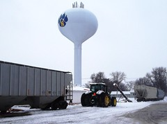 Nevada, Iowa, Union Pacific Railroad, Grain Hoppers, Tractor, Water Tower (photolibrarian) Tags: tractor watertower unionpacificrailroad nevadaiowa grainhoppers