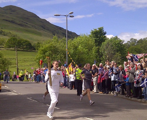 Myles Clark withj Ilympic flame in Tarbet