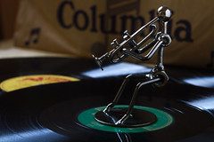 All that jazz (Michel Couprie) Tags: sculpture stilllife records canon eos dof steel trumpet jazz columbia 100mm 7d reflets reflects trumpetplayer acier disques trompette trompettiste 78tours