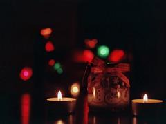 F1020005 (Zeljka_R) Tags: christmas red black reflection film analog 35mm dark lights nikon candles bow jar f401s