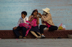 Different interests (Jonas Hansel) Tags: family boy woman girl digital canon river children geotagged eos rebel kiss cambodge cambodia kambodscha khmer child daughter mother son front quay phnompenh riverfront tamron tone mekong sap phnom penh picknick cambodja t3i x5 kampuchea 600d sisowath 2013 18270 phnumpenh phnum tamron18270 canonrebelt3i canonkissx5