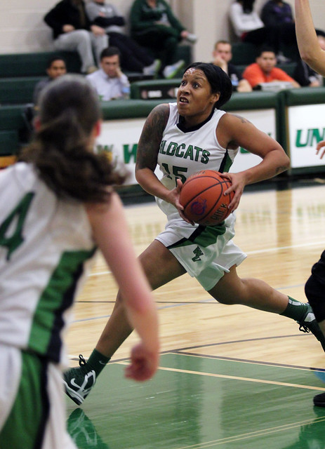 Senior Danielle Thomas drives the lane in the first half against Holy family on Tuesday. Copyright 2013; Wilmington University. All rights reserved.