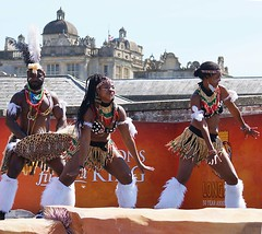 An African Summer at Longleat (Annette Rumbelow) Tags: longleatcelebrating50thanniversary longleatsafaripark longleatgrounds annetterumbelowwilson anafricansummer costume costumes performers outside outdoors people entertainment entertain colour texture smiles smile sunshine dof dancing drums dance singing rhythmofthesavannah beads paint painted faces face portrait landscape entertainers jewellery performer laughter africa beauty stage movement feathers shield happyfaces happiness light brilliantsunshine headdress happyface