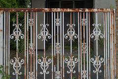 rusty gate (kasa51) Tags: gate fennce door house building abandoned ruined rusty weed yokohama japan