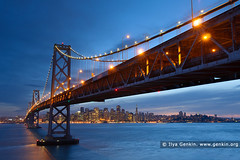 Oakland Bay Bridge at Sunset, San Francisco Bay, California, USA (ILYA GENKIN / GENKIN.ORG) Tags: ocean sanfrancisco california road travel bridge sea sky usa southwest west water weather america landscape outside outdoors bay coast us marine scenery skies treasureisland view unitedstates pacific suspension outdoor over shoreline scenic scene structure safety coastal american shore maritime transportation baybridge western bayarea vista northamerica coastline sanfranciscobay sfbayarea suspended visible span saltwater visibility yerbabuenaisland oaklandbaybridge spanning