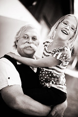 Her grandpa II (Erica Gilbertson) Tags: usa love girl beautiful smiling sepia laughing canon wonderful happy kid hugging holding hug child tshirt grandpa grandchild laugh smilie hugs mustasch 5dmarkii