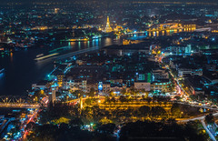 Bangkok cityscape (Weerakarn) Tags: city light skyline night landscape thailand temple boat cityscape nightscape traffic bangkok nightlight watarun beautifulview chaophrayariver saphanphut bangkokskyscraper