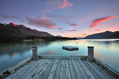 Lake Wakatipu at Dusk (Nadly Aizat) Tags: new blue sunset newzealand summer sky panorama mountain lake snow mountains alps reflection tree tourism nature water beautiful clouds landscape outside outdoors island mirror pier countryside scenery day view outdoor dusk turquoise background jetty south shoreline scenic peaceful sunny images lakeside southern reflected zealand wharf getty southisland queenstown peaks polarized picturesque range capped idyllic wakatipu waterscape glenorchy wakitipu