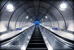 Event Horizon (Aaron Yeoman) Tags: lighting city uk greatbritain travel blue england urban london lines station metal architecture modern silver underground subway grey lights europe quiet arch metro unitedkingdom empty curves escalator perspective railway tunnel arches symmetry spotlight line gb symmetrical docklands tubestation londonunderground subwaystation curve vignetting vignette southwark thetube jubileeline metrostation spotlights a77 tfl lul theunderground undergroundstation rapidtransit southeastlondon metropolitanrailway southwarktubestation southwarkundergroundstation sigma1020mm1456exdchsm sonya77 slta77 sonyalphaslta77