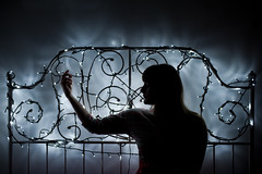 Let the moonlight take the lid off your dreams. (evilibby) Tags: light silhouette dark lights bed quiet silent curves christmaslights libby 365 curve bedframe curved fairylights mybedroom hemma 3655 365days 365days5