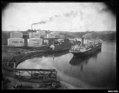 Shell Oil terminal, possibly Gore Bay Terminal in Sydney, with a ship moored beside it, 1925-1940