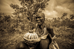 Surma tribe old woman smoke from the typical pipe (anthony pappone photography) Tags: africa travel portrait woman black art face digital canon pose photography eyes artist faces image expression retrato african smoke pipe picture culture unesco tribes afrika omovalley oldwoman fotografia ethiopia ritratto surma reportage photograher afrique faccia eastafrica phototravel suri etiopia etnic 非洲 etnico etiope etnia アフリカ loweromovalley etnica etnologia afryka losniños etiopija 아프리카 etiopien etiópia kibish africantribe африка etiopi tulgit अफ्रीका lowervalleyomo womantribe