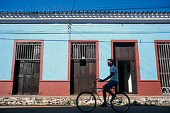 Blue painted house, Remedios, Cuba (Fugamundi) Tags: road street house man color colour building bicycle horizontal architecture facade day cyclist exterior cuba scene greater antilles remedios cmwdblue