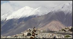Faith..Ladakh (maulik shahh) Tags: road trip morning travel summer mountain snow ice landscape religious photography hope photo rocks photographer tour photos faith snowcapped himalayas cairn ladakh mountainscape rockpiles maulikshah