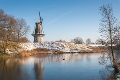Dutch windmill in winter - Molen 'Nooit Gedagt' in Woudrichem (RuudMorijn) Tags: blue winter sky snow cold holland mill monument nature water netherlands windmill dutch architecture rural vintage landscape countryside construction europe blauw technology power natural wind snowy traditional sneeuw rustic seasonal grain sails scenic peaceful landmark historic environment rotation tradition agriculture lucht polder picturesque fortress zwart blauwe brabant dike turning hemel molen gracht zwarte noordbrabant ijs windmolen rotate zwaan wintry northbrabant vestingstad octagonal walmolen cornmill korenmolen woudrichem besneeuwd nooir gedagt rijkswal