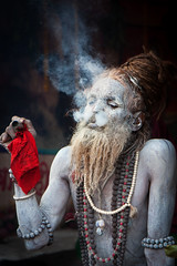 Smoke (Satyaki Basu) Tags: street travel camp portrait people india saint canon eos weed indian smoke transit devotee kolkata bengal baba calcutta maidan sadhu naga ganja westbengal 1755 gangasagar 450d babooghat gettyimagesmiddleeast