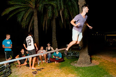 Flying stranger (Miles Cave) Tags: boy man tree grass flying rope palm slack strobist