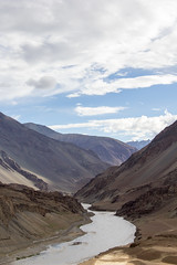 The valley of Zanskar and Indus rivers confluence, Ladakh (Amal Mourya) Tags: amal mourya amalmourya valley zanskar indus rivers confluence ladakh jammukashmir india sand blue mountain adventure junction confluent natural turn river cloud travel sindhu flow brown deserted attraction sunny curve scenery stream gorge trekking morning himalaya sun slope asia plateau canyon panorama kashmir altitude sky scenic tourism leh water nature himalayan road landscape jammu traveldestinations cloudsky